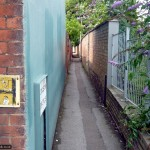 This narrow alley takes you to residential streets