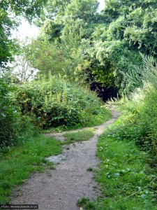 A side path leads off towards the site of a Roman villa