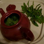 Nettles in a teapot with mint leaves