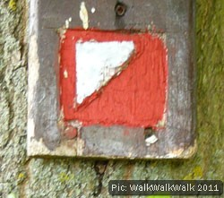 Orienteering symbol on a wooden plaque