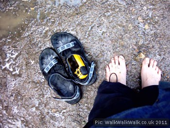 Bare feet, sandals and a GPS receiver